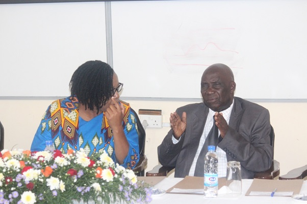Prof. C. Mararike (right) responding to questions after presenting on the tool kit for professional conduct while Prof C. Manyeruke (left) listens attentively
